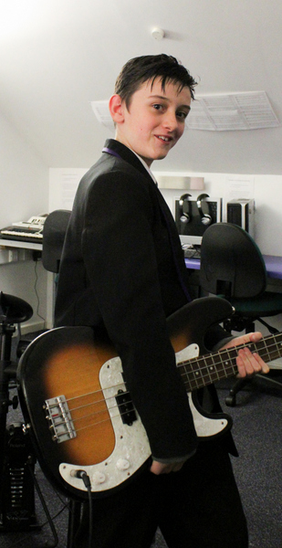 ARK Kings Academy Band Musicianship student Louis with bass guitar