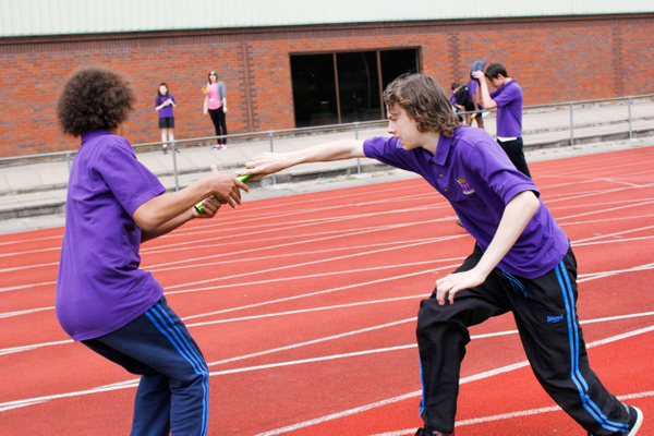 ARK Kings Academy male athletes pass relay baton at Sport Day 2015