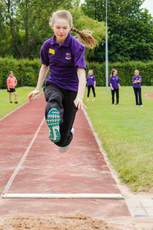ARK Kings Academy female student mid-air long jump competition Sports Day 2015