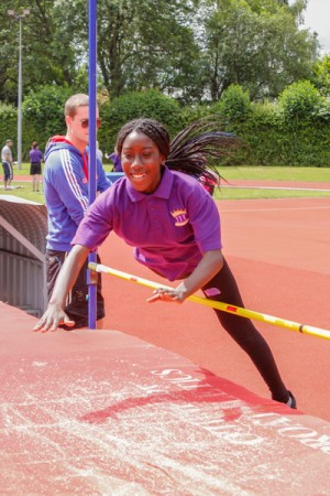 Female ARK Kings Academy student competes in high jump competition Sports Day 2015