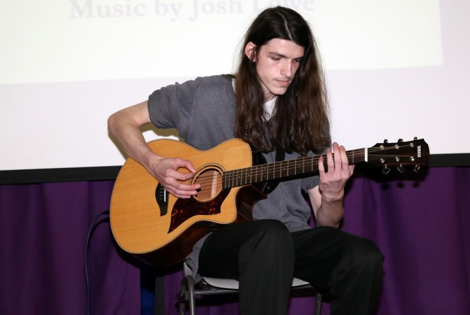 ARK Kings student musician playing guitar