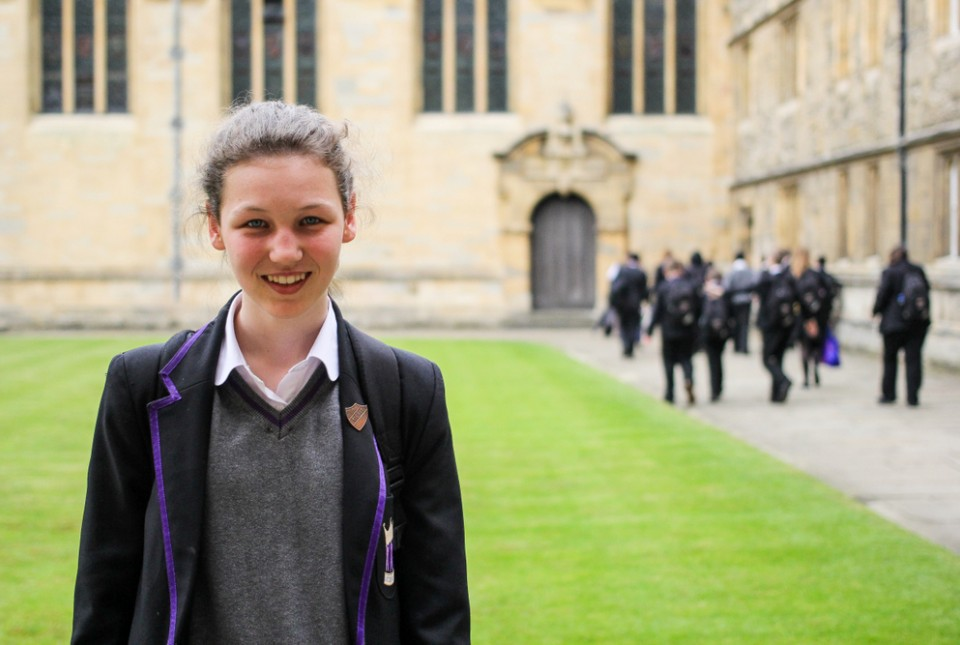 ARK Kings Academy student smiling whilst standing in the garden of Wadham College at the University of Oxford