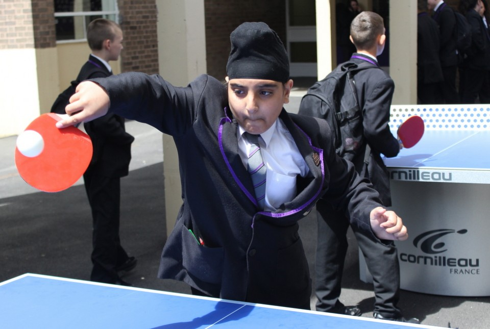 ARK Kings student playing table tennis in school playground