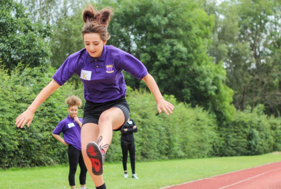 ARK Kings Academy female student competing in the long jump competition at Sports Day 2014