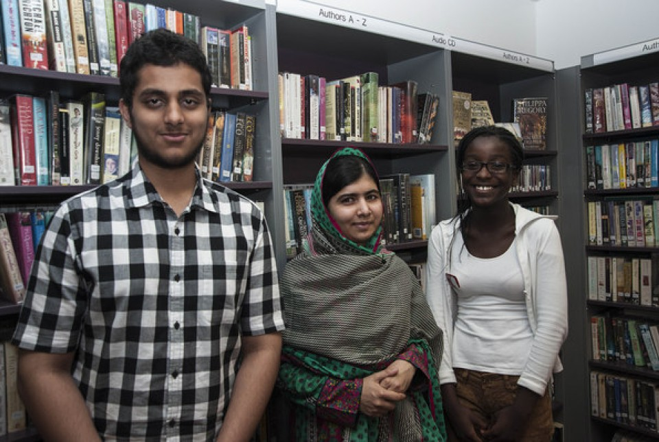 Students from ARK Kings Academy standing with the education campaigner Malala Yousafzai in a school library