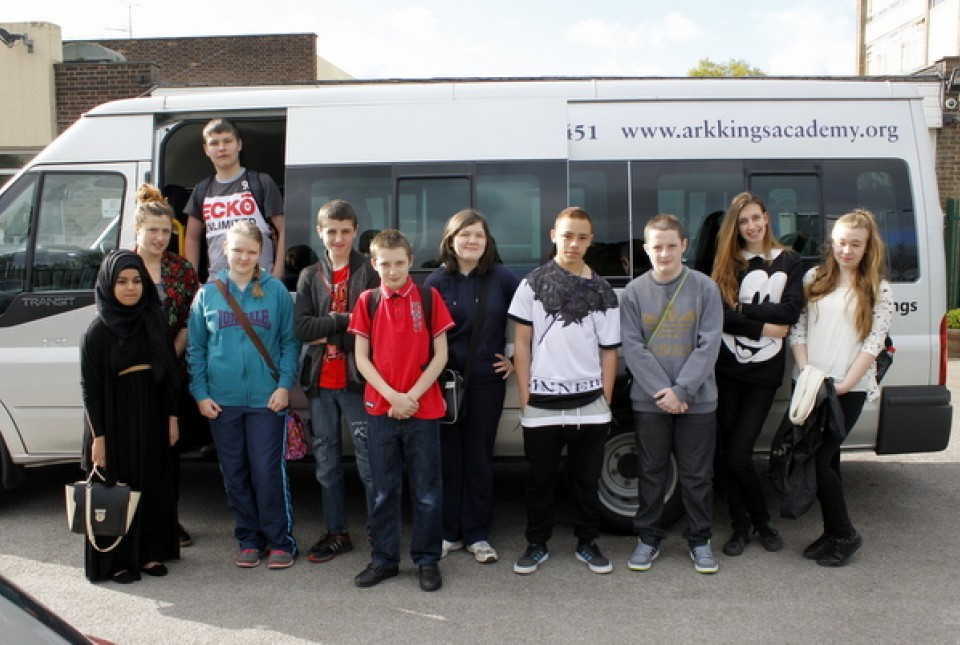 Members of ARK Kings Academy's student leadership team stand with Miss Redhead next to the school minibus