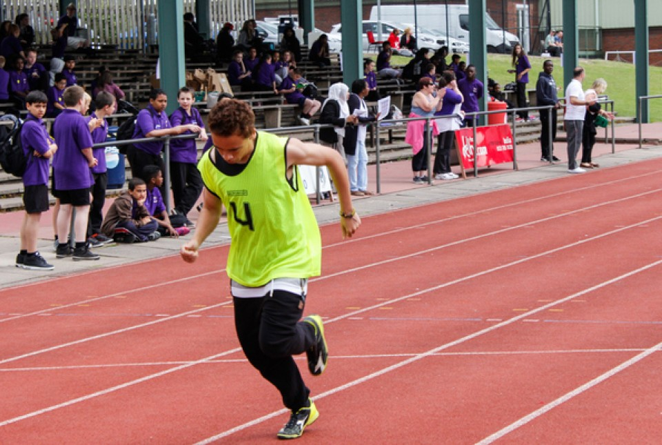 male student athlete running in a race at ARK Kings Academy Sports Day 2015