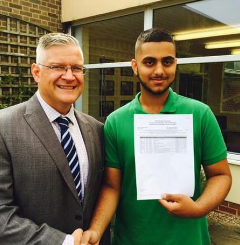 Roger Punton, principal at ARK Kings congratulates Sufiyan on GCSE success