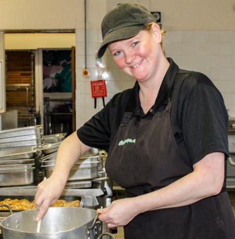 deputy cook at ARK Kings Academy Linda Dennington preparing a chicken and leak pie
